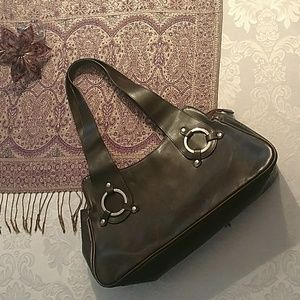 Handbags - Brown leather purse with silver trim.